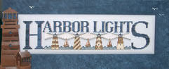 click here to view larger image of Harbor Lights - charmed sampler (chart with charms/buttons)