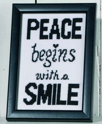 click here to view larger image of Peace Begins With A Smile (counted cross stitch kit)