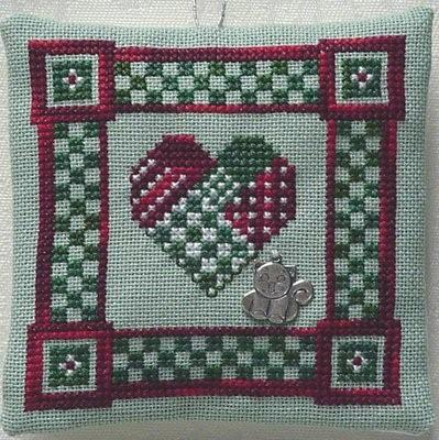 click here to view larger image of Kitten on a Christmas Quilt  (w/charm) (chart with charms/buttons)